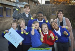 Jefferies' Director Nina Ramsden with primary school children after donating reflective safety bands